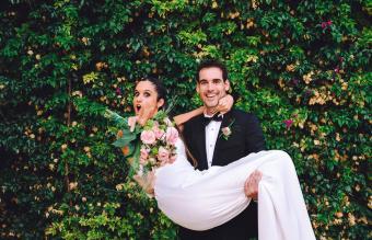 Happy groom holding bride