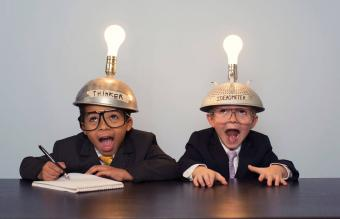 Two Young Boy in Thinking Caps