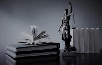 Books And Lady Justice Figurine