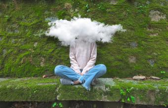 woman with head in the cloud