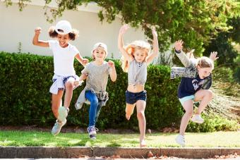 kids jumping outdoors on a summer day