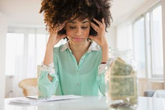Stressed woman paying bills