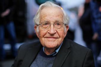 Noam Chomsky pictured during a press conference - Getty Editorial Use