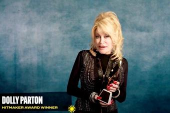 Dolly Parton accepts the Hitmaker Award during the Billboard Women In Music 2020