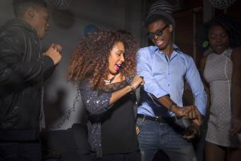 Young man and woman dancing at house party