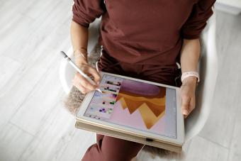 web designer using tablet at home