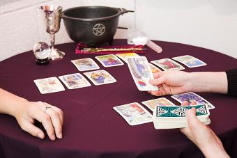 Woman telling another woman's future with tarot cards