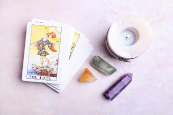 deck of tarot cards and mineral stones