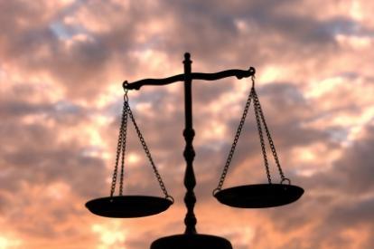 The scales; Libra's symbol.