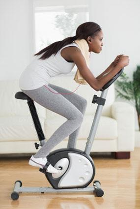 Woman working out on exercise bike