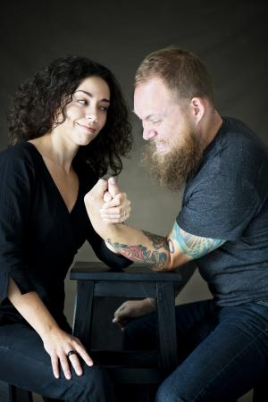 couple arm wrestling