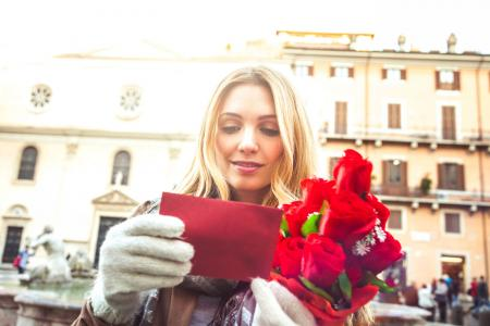 Woman receives red roses