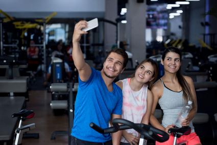 man taking selfie at gym