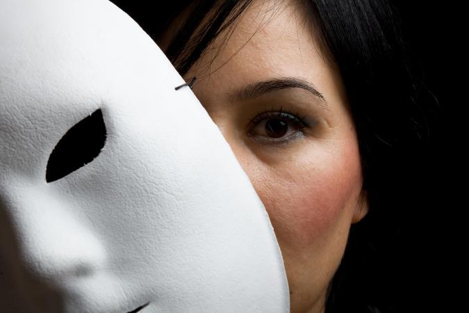 Woman Behind Mask
