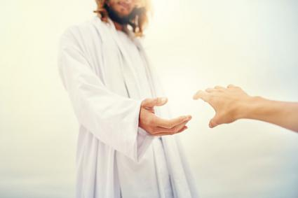 Jesus standing with his hand outstretched toward a follower.