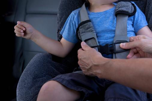 Mother fastening child seat belt