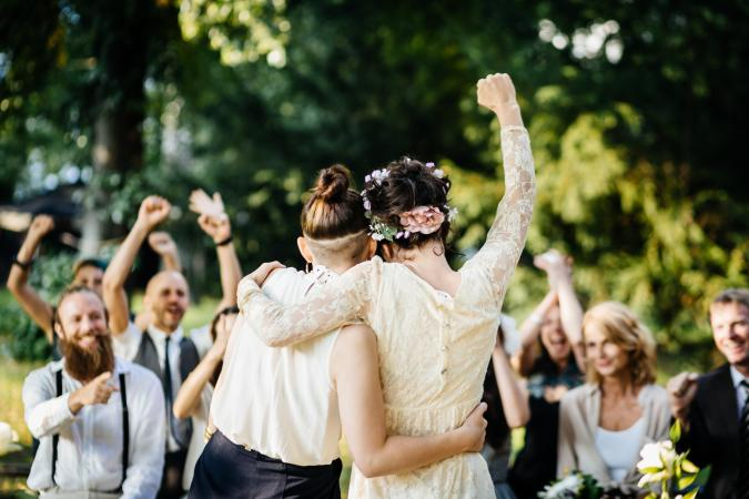 Newlywed brides excited at end of ceremony