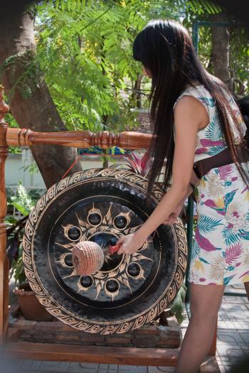 Woman banging gong