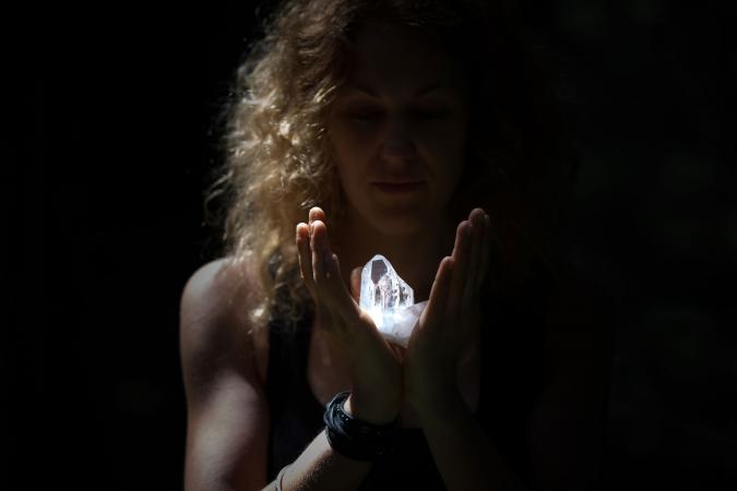 Woman holding healing crystal