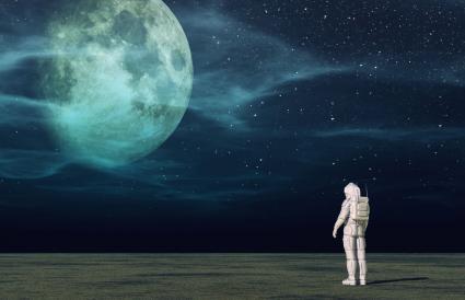 Astronaut looks to the moon