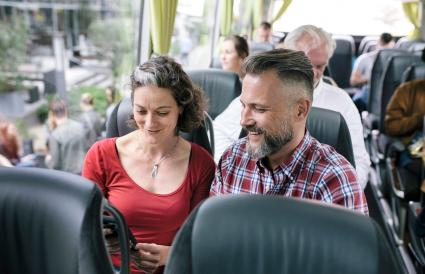 Couple Travelling On A Bus