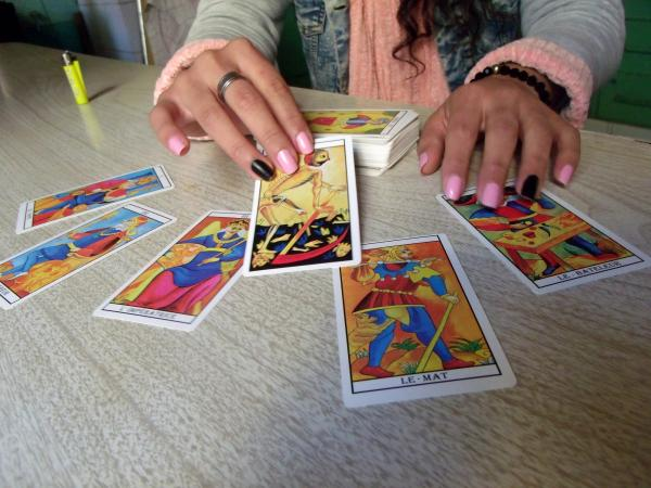 woman with tarot spread