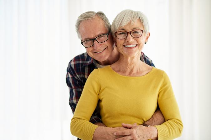 Smiling happy older couple