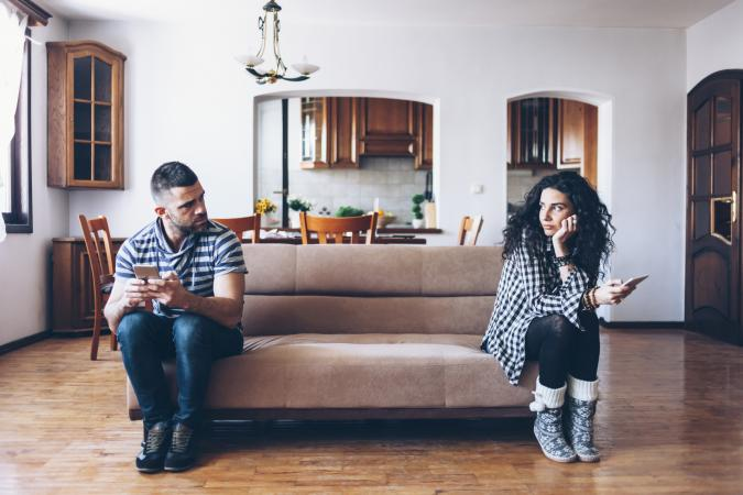 Couple on opposite ends of sofa