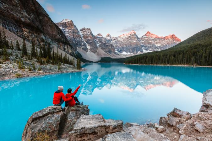 Adventurous couple by a mountain lake