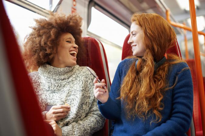 Two women talking on a train