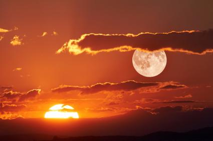 Scenic View Of Full Moon During Sunset