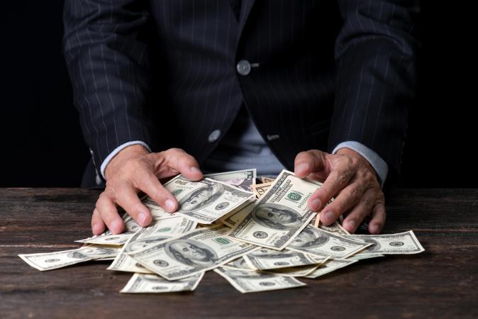 man handling paper money