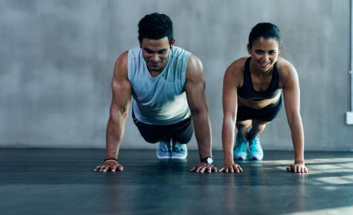 Couple doing planks or pushups