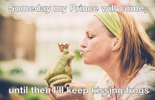 Woman kissing a frog