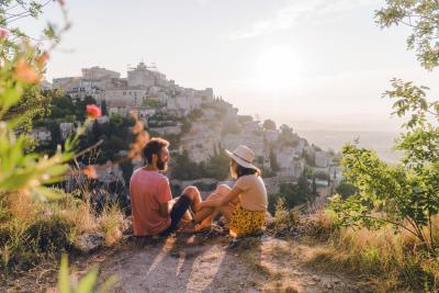 Woman and man looking at scenic view of Gordes village in Provence