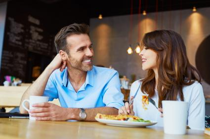 Couple at cafe talking during lunch