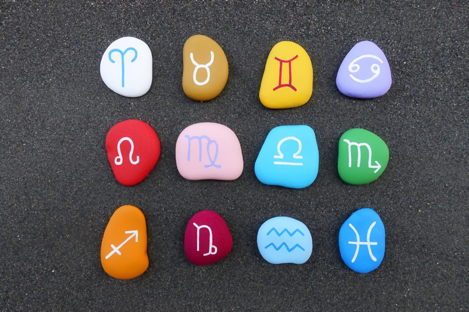 Astrology Signs Pebbles On Table