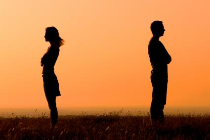 Silhouette man and woman facing away from each other