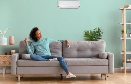relaxed woman sitting on couch