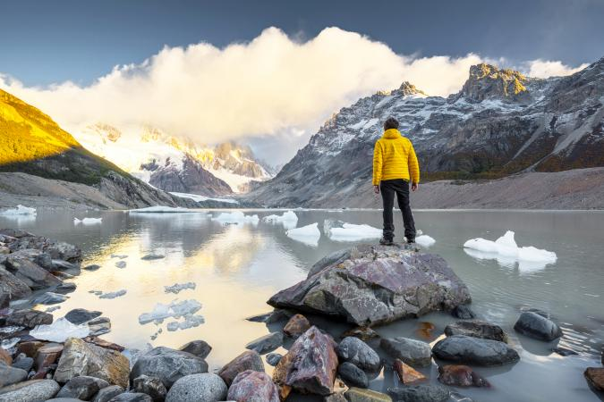 Man looking at view at sunrise in Los Glaciers national park