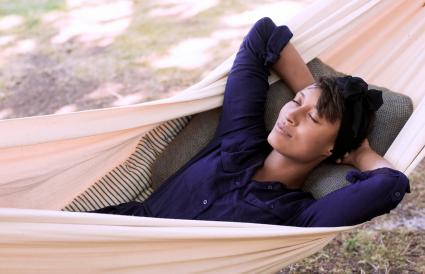 Woman lying in hammock