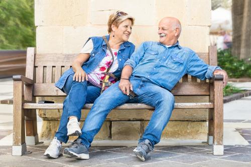 Senior couple wearing blue denim