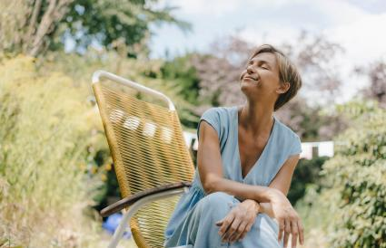 Relaxed woman sitting in garden