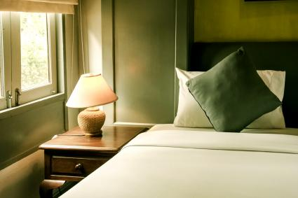 Green Pillows On Bed At Home