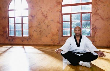 man meditating on floor