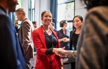Businesswomen handshaking