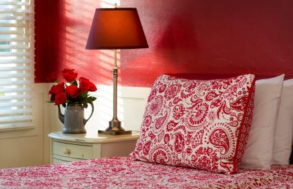 Red themed bedroom with patterned bedding
