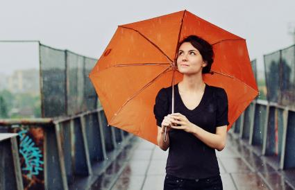 woman with orange umbrella