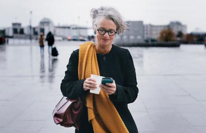 Businesswoman Smiling While Texting
