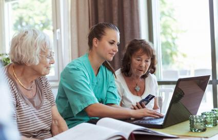 Nurse with senior women buying medicine online